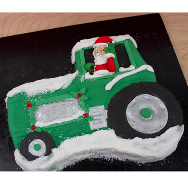 Santa in a Tractor Cake